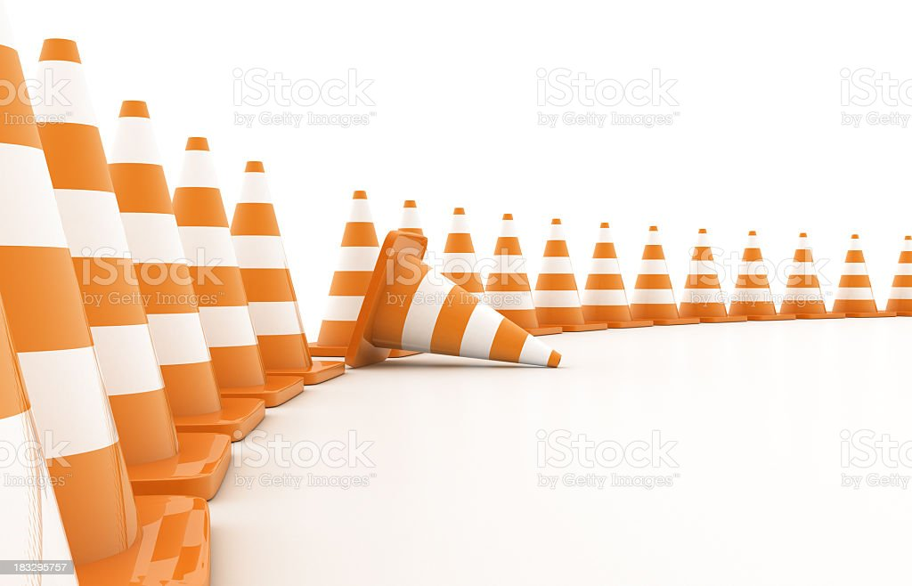 Curved line of orange traffic cones with one knocked over stock photo