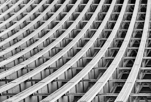 Curved Metal Girders supporting a railway bridge