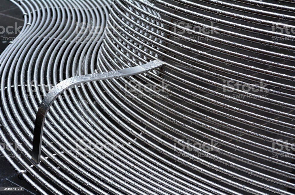 Curved metal surface stock photo