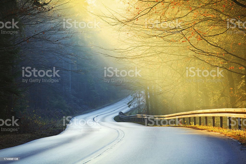 Curved Mountain Road - Illuminated by Mornig Sun Rays stock photo