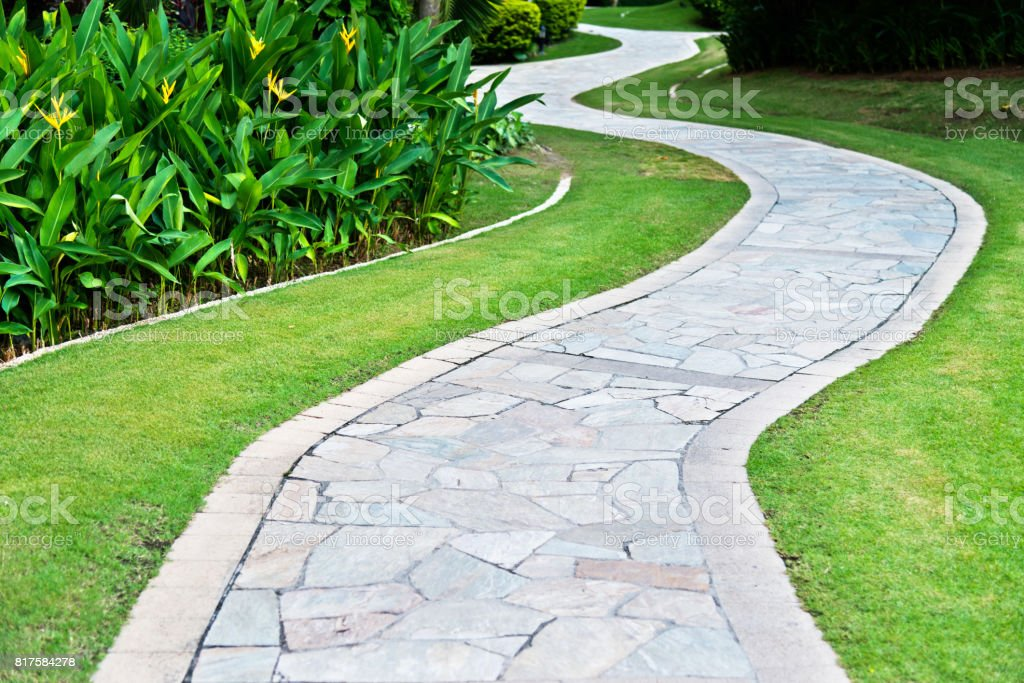 Curved path in the formal garden stock photo