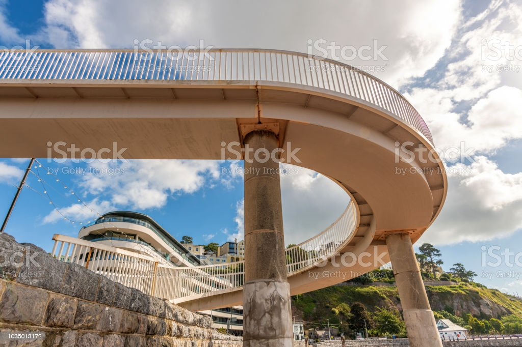 Curved pedestrian walkway by the beach in Torquay, Devon stock photo