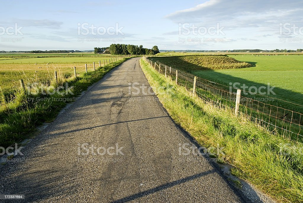 Curved Road on a Dyke royalty-free stock photo
