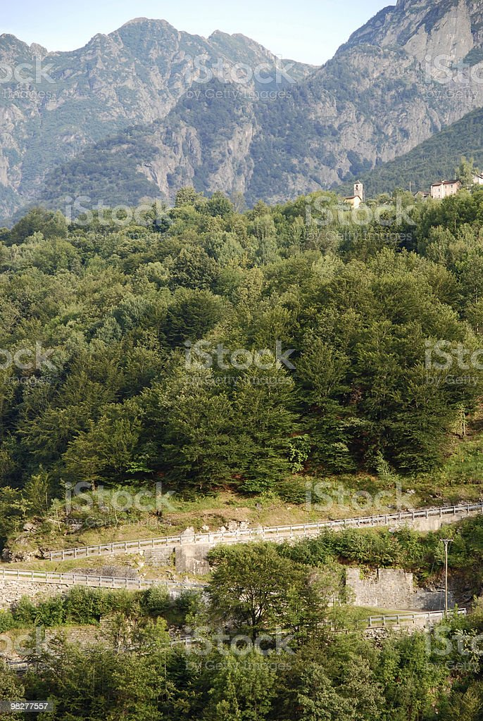 curved road to alpine village royalty-free stock photo