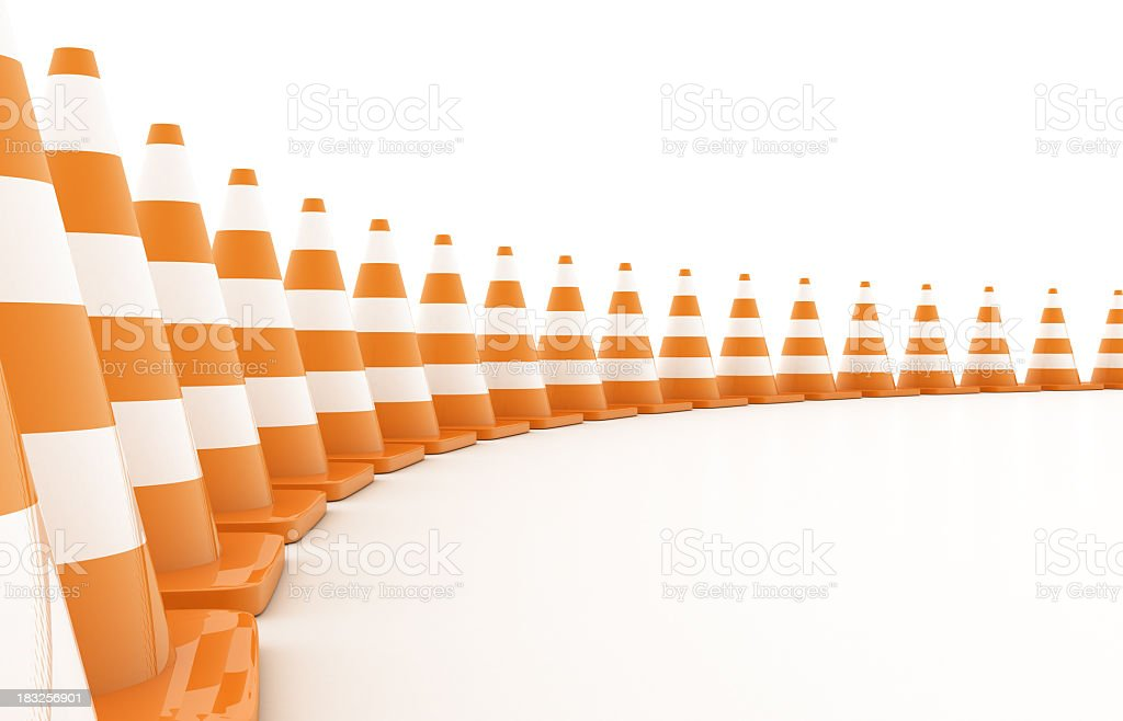 Curved row of orange traffic cones stock photo