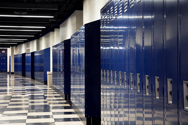 """Curved School Hallway """"An empty, curved hallway of a high school lined with blue lockers"""" high school building stock pictures, royalty-free photos & images"""