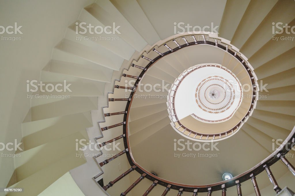 Curved stairway that view from below in Kolkata, India. stock photo
