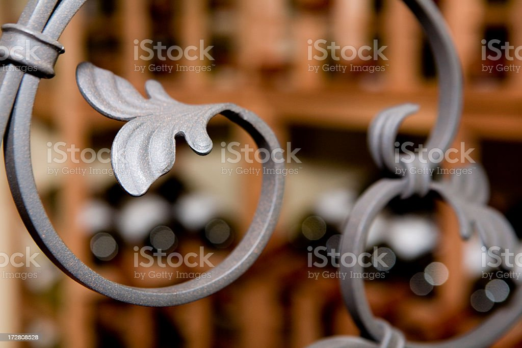 A curved wrought iron bar with leaf details stock photo