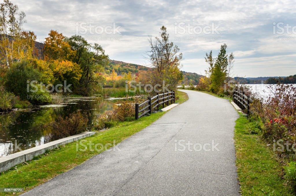 Curving Cycle Path alongside a Mountain Lake stock photo