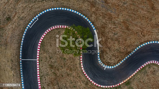 istock Curving race track view from above, Aerial view car race asphalt track and curve. 1136509474