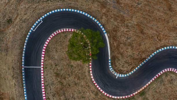 curving race track view from above, aerial view car race asphalt track and curve. - formula 1 стоковые фото и изображения