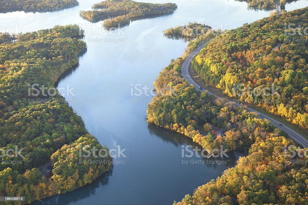 Curving road along Mississippi River during autumn stock photo