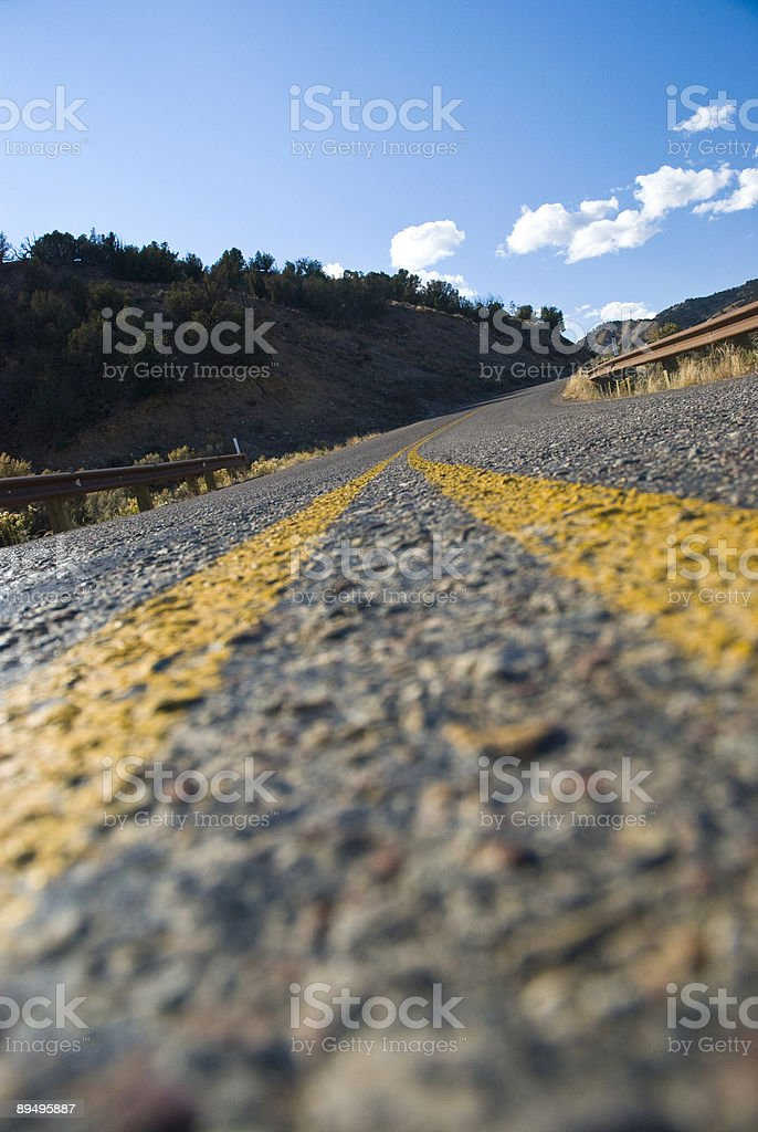 Curving Road and Guard Rail in the Mountains royalty free stockfoto