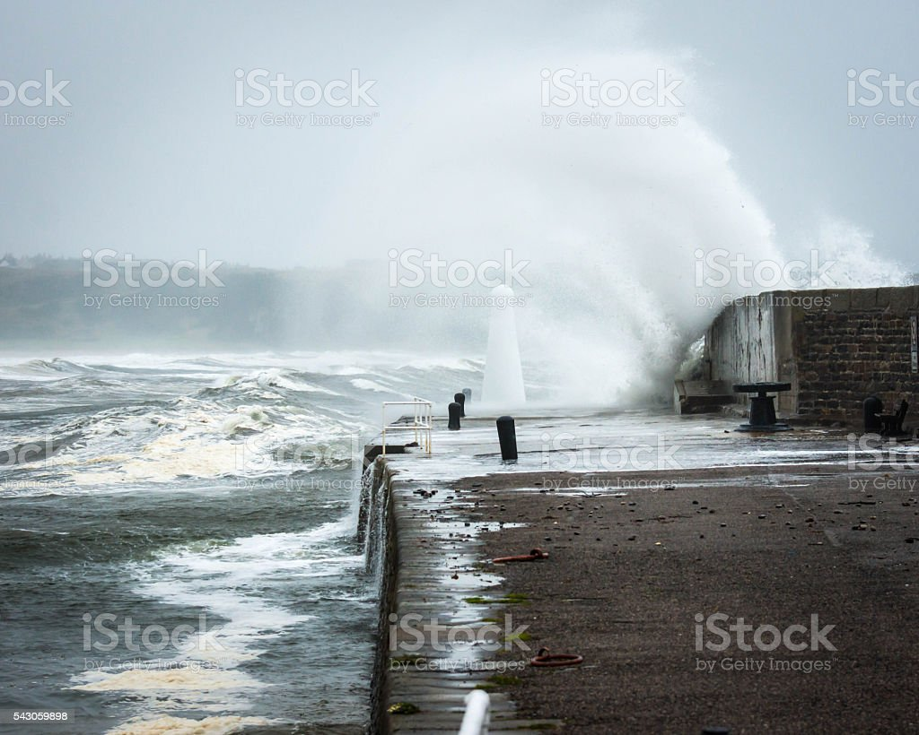 Curving Wave and Lighthouse stock photo