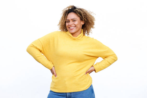 curvy african american woman smiling against isolated white background Portrait of curvy african american woman smiling against isolated white background afro caribbean ethnicity stock pictures, royalty-free photos & images