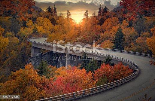 istock Curvy autumn road 540717610