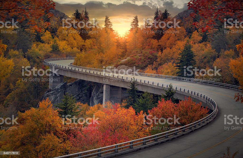 Curvy autumn road stock photo