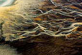 istock Curvy flow of glacial rivers through a dream-like landscape of Iceland, taken from a helicopter 1252669650
