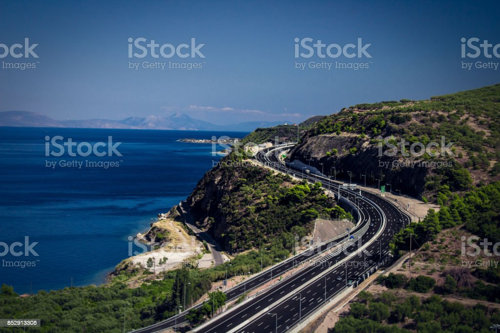 curvy highway above the ocean at the edge stock photo