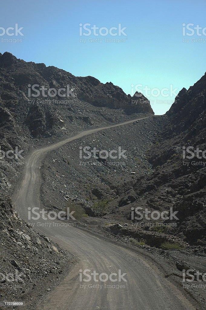 Curvy mountain gravel road royalty-free stock photo