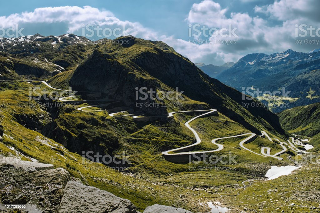 Curvy road from a valley to the mountain pass stock photo