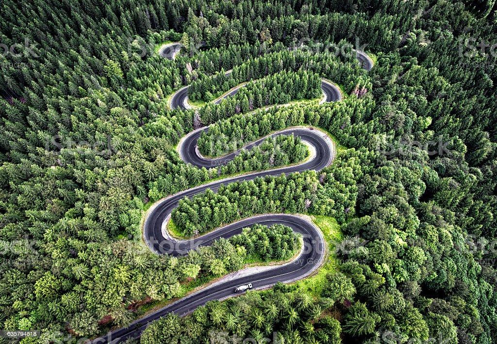 Curvy road from the high mountain pass in Transalpina, Romania. stock photo