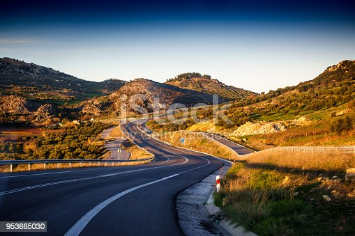 Scenic view of a curvy road amidst deserted area, Greece