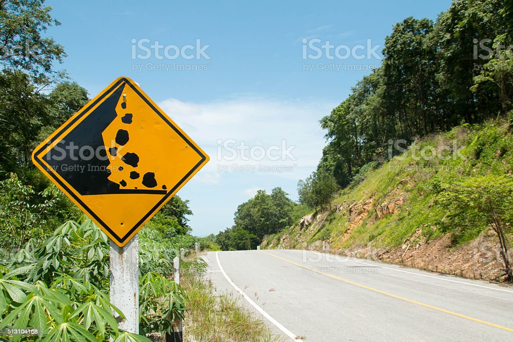 Curvy road sign to the mountain in rural area stock photo