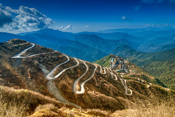 curvy roads , silk trading route between china and india - road map stock photos and pictures