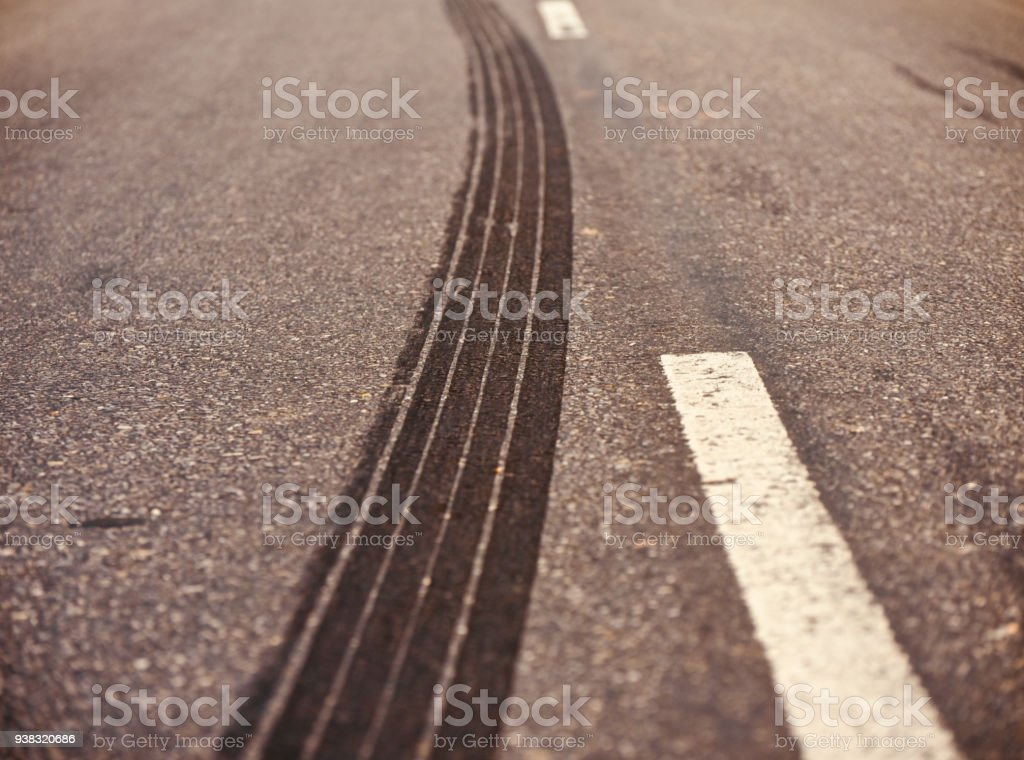 A curvy tyre marks on a street unique stock photo stock photo