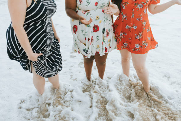 Curvy women at the beach Curvy women at the beach body positive stock pictures, royalty-free photos & images