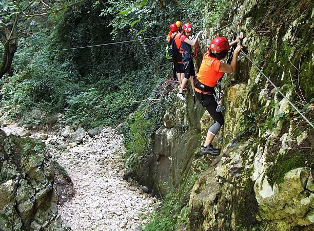 Cusano Mutri - Percorso avventura di Conca Torta Cusano Mutri, Benevento, Campania, Italy - June 26, 2016: Hikers roped along the path of the Gorge Adventure Conca Torta. These are Reviola gorges carved by the river, a tributary of Titerno River, which runs between Mount Calvary and the upper area of the village of Cusano Mutri. percorso stock pictures, royalty-free photos & images