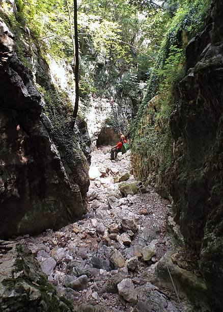 Cusano Mutri - Guida del percorso avventura Cusano Mutri, Benevento, Campania, Italy - June 26, 2016: one of the two guides accompanying walkers along the path of the Gorge Adventure Conca cake. These are Reviola gorges carved by the river, a tributary of Titerno River, which runs between Mount Calvary and the upper area of the village of Cusano Mutri. percorso stock pictures, royalty-free photos & images