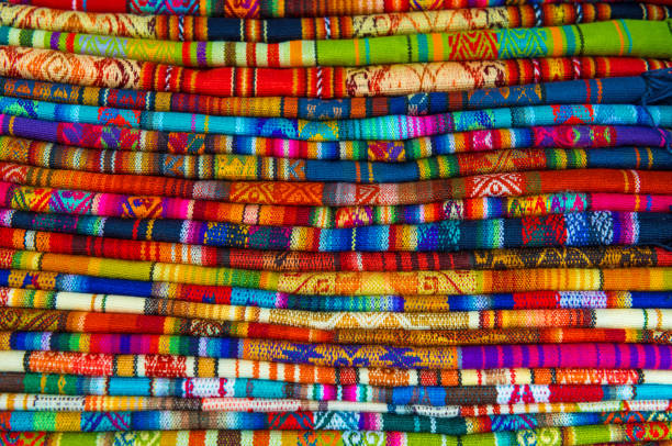 Cusco Market Textiles A pile of traditional handmade Andean textiles in the local handicrafts market of Cusco, Peru. peruvian culture stock pictures, royalty-free photos & images