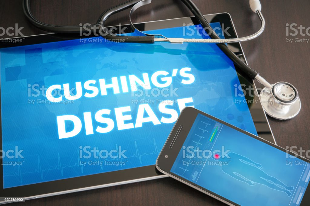 Cushing's disease (endocrine disease) diagnosis medical concept on tablet screen with stethoscope stock photo