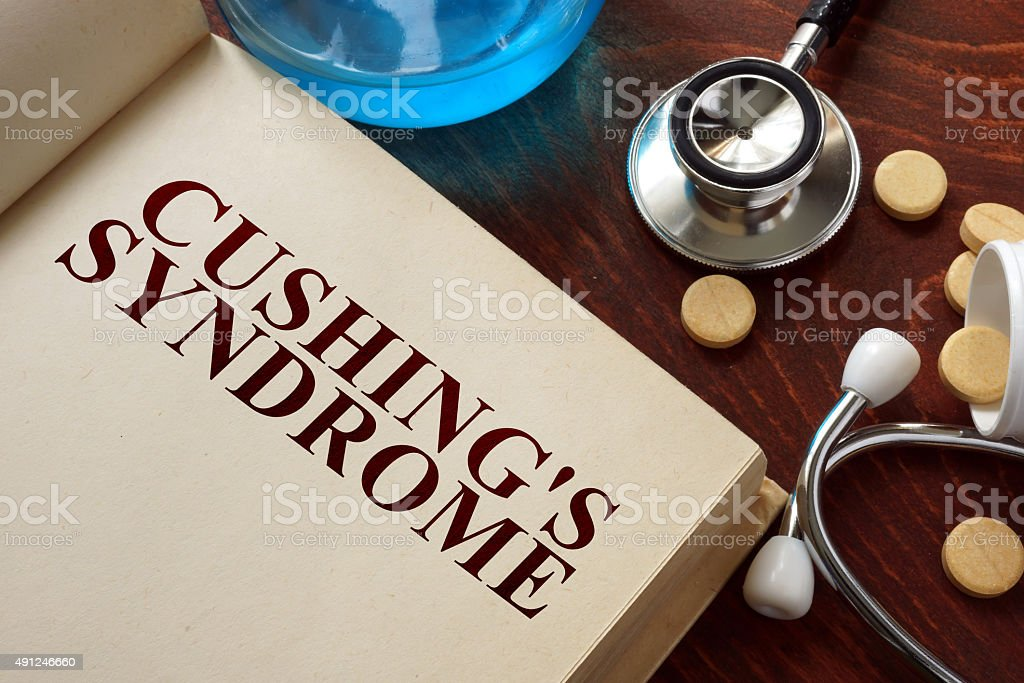 Cushings syndrome  written on book with tablets. stock photo