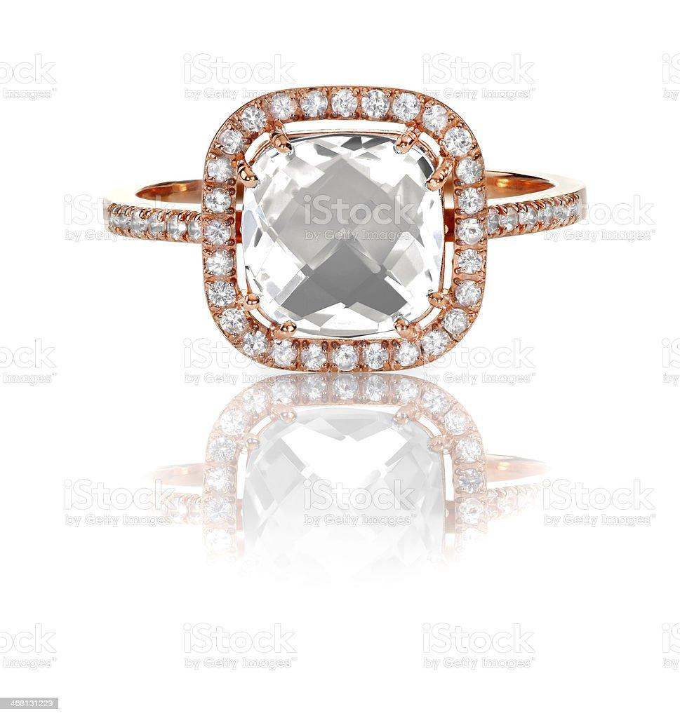 Cushion cut diamond ring in rose gold halo setting. stock photo