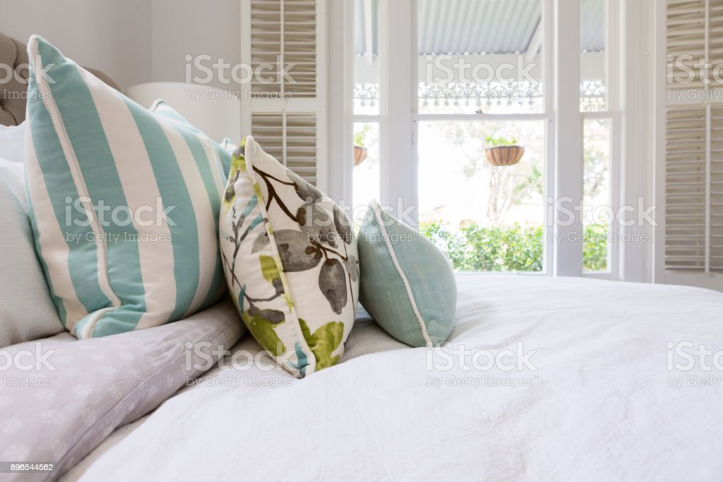 Cushion details in a luxury country house bedroom stock photo