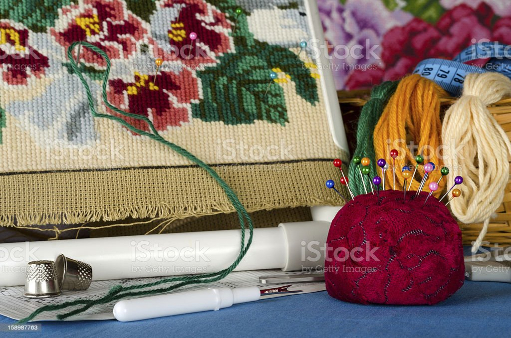 Cushion for pins and a set of cross stitching royalty-free stock photo