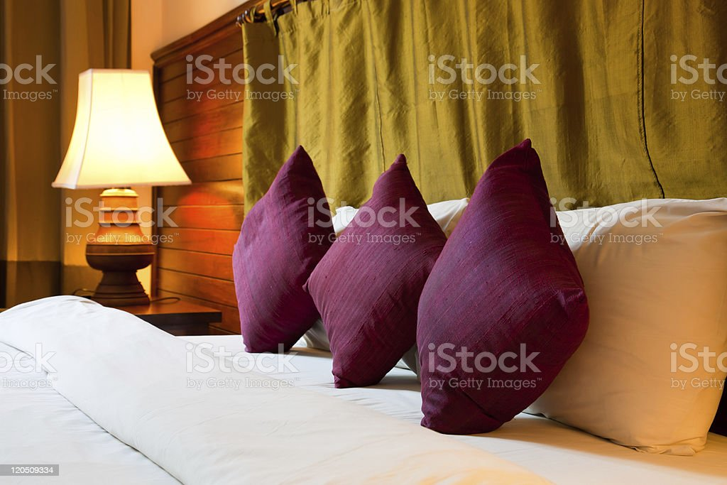 cushion on the bed royalty-free stock photo