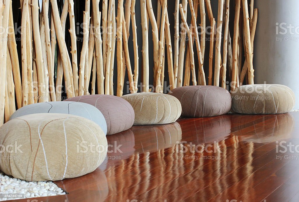Cushion seat in quiet interior room for meditation stock photo