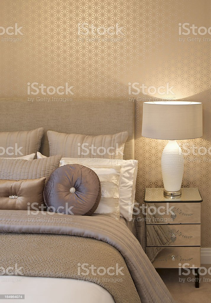 cushions, bed and bedside table stock photo