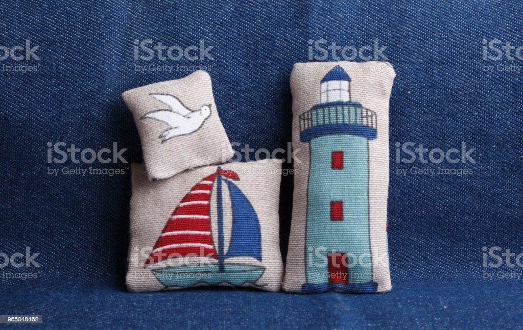 Cushions with sea symbols royalty-free stock photo