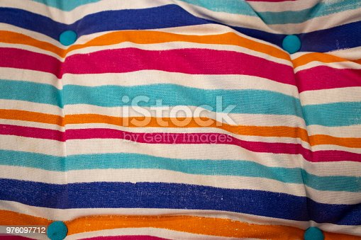 Cushy cushion summer stripes background - selective focus