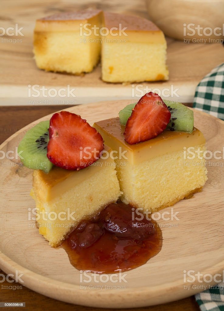 custard cake fruits jam on wood plate and fork stock photo