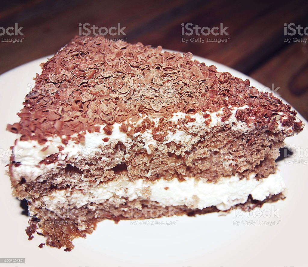 Custard Cake with chocolate shavings and curls - vintage effect. royalty-free stock photo
