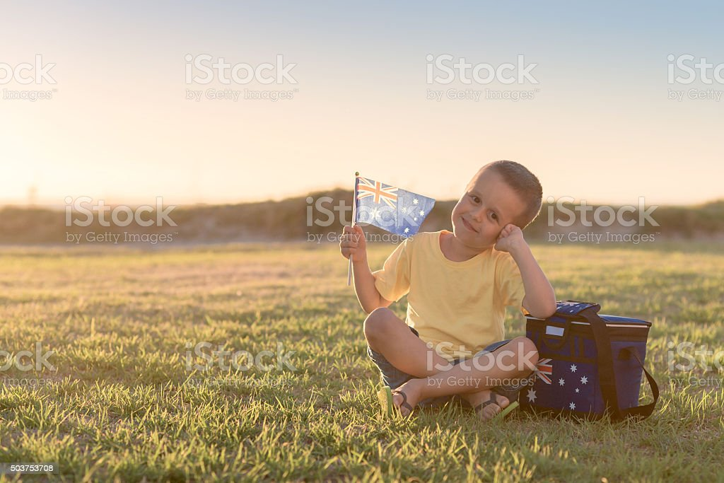 Custe smiling kid with flag of Australia stock photo