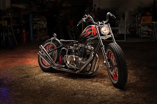 Custom bobber motorbike. Vintage style motorcycle in an workshop garage.