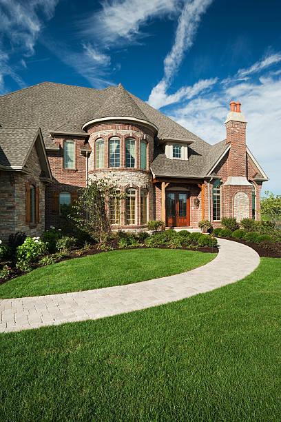 Custom built brick home on summer day. stock photo