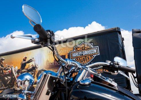 Antalya, Turkey - May 12, 2013: Harley Davidson is Americas greatest manufacturer of motor cycles. Black custom Harley davidson motorcycle photographed with Harley Davidson Store.Motorbike.